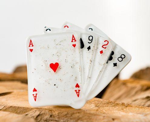 waaier van kaarten als persoonlijke asbestemming van glas