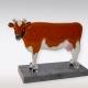Urn Fries bonte koe van glas met crematie-as