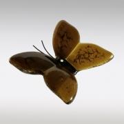 Bruin vlindertje van glas met as van kat
